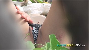 friend gives helping hand on public nude beach and watches him cum